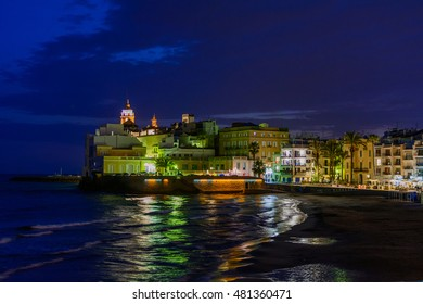 Sitges, Spain - June 10: Illuminated sea shore and buildings on June 6, 2016 in Sitges, Spain. This coastal city in Catalonia is famous for its Film Festival and Carnival.