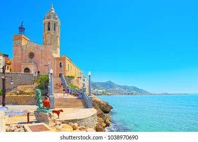 Sitges, Spain - June 14, 2017 : Sitges Town Hall and Church  Parish of Saint Bartholomew and Santa Tecla in small resort town Sitges, in the suburbs of Barcelona.