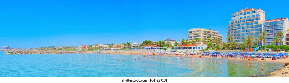 Sitges, Spain - June 14, 2017 : View of the beach and the sea shore of a small resort town Sitges in the suburbs of Barcelona. Spain.
