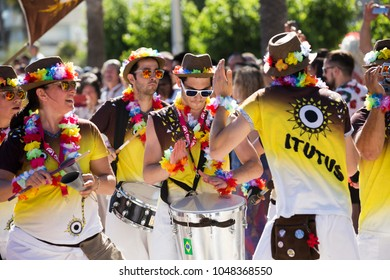 SITGES, SPAIN - JUNE 19, 2016: cheerful people wearing bright makeup and costume on pride parade in Sitges, Catalonia