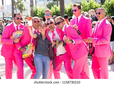 SITGES, SPAIN – JUNE 19, 2016: men in bright costumes celebrating Pride Parade event in Sitges, Spain