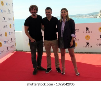 "SITGES, SPAIN - October 11, 2018: 51st Sitges Film Festival - Photo call of ""El año de la plaga"" - Iván Massagué, Carlos Martín Ferrera and Miriam Giovanelli"