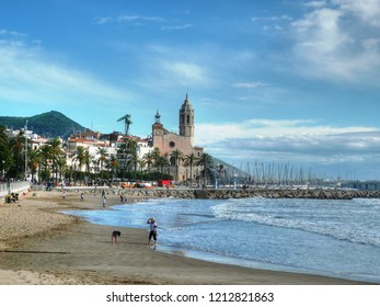 SITGES, SPAIN - OCTOBER 31, 2014: View of the beach and the Church of Sant Bertomeu and Santa Tecla in Sitges.