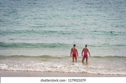 Sitges, Spain, September 2018. Gay couple on vacation at the beach in Sitges, Barcelona province. One of Spain or even Europe's top gay destination