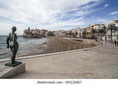 SITGES,SPAIN-JANUARY 30,2013: Maritime promenade, statue, beach and village view, Sitges, province Barcelona, Catalonia.