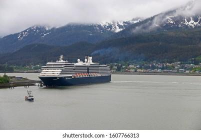 Sitka, Alaska - MAY 20: MS Westerdam owned by Holland America sailing through snow mountain  at Sitka, Alaska on May 22, 2014.