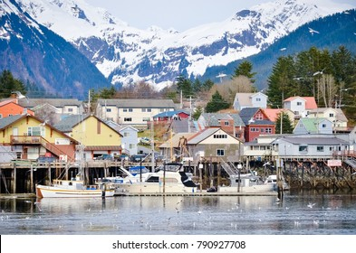 Sitka, Alaska / USA - April 22, 2013: View Of Sitka Alaska Boats and Buildings from the Water with Mountain Background