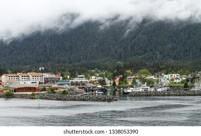 Sitka Alaska from the water on a grey cloudy day.