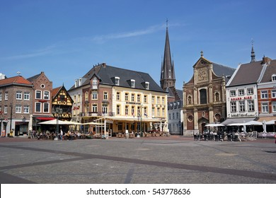 SITTARD, THE NETHERLANDS - MAY 11: View of Sittard market square with historic houses, Sidewalk cafe and a church. Photo taken on May 11th, 2016 in Sittard, The Netherlands.