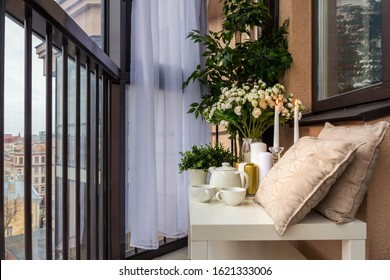 sitting area in a cozy loggia with a view of the city