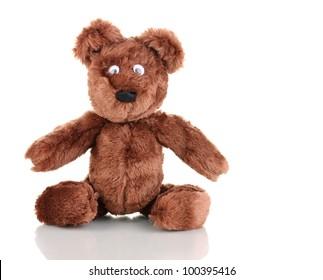 Sitting bear toy isolated on white