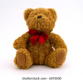 Sitting brown Teddy bear on neutral background.