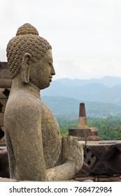 Sitting Buddah statue in Borobudur Buddhist temple in Java