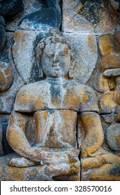 Sitting Buddha encarved in stone, found at Borobudur Indonesia, biggest buddhist temple in