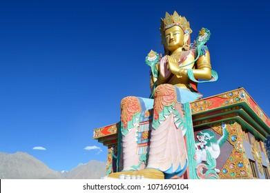 Sitting buddha statue. Diskit Monastery. Nubra valley travel. Ladakh monastery