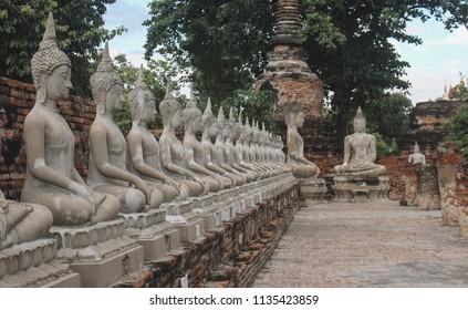 Sitting buddha statues in a row at Wat Yai Chai Mongkhon temple in Ayutthaya, Thailand