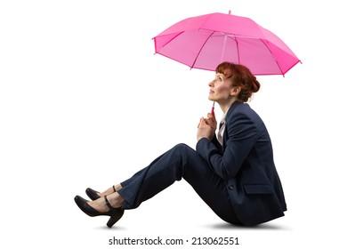 Sitting businesswoman holding pink umbrella on white background