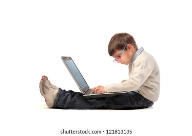 Sitting child using a laptop computer