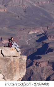 Sitting at the edge of Grand Canyon