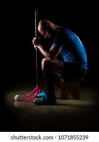 Sitting floorball player. Studio photography