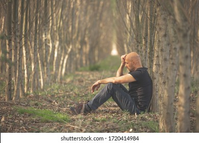 Sitting man with depression going through a rough patch in his life, suffering from mental exhaustion, anxiety, burnout