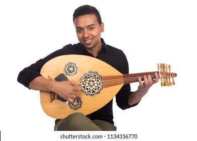 Sitting musician holds the lute looking at the camera smiling, isolated on a white background.