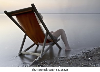 sitting on a deckchair at sunset
