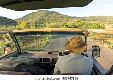 Sitting on the safari jeep to explore the savannah in africa
