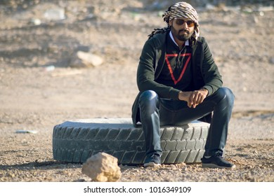 sitting on a tier in desert