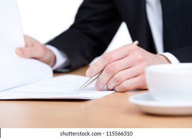 Sitting at the table business man making notes in the notebook