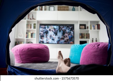 I am sitting in tent at home watching tv