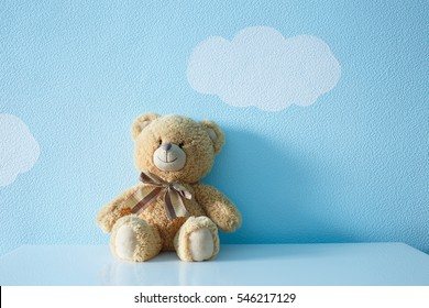Sitting toy bear on the background of Wallpapers of clouds and sky