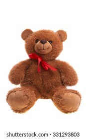 sitting toy teddy bear wearing red neck bow isolated over white