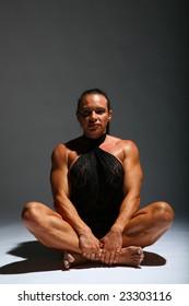 Sitting woman bodybuilder