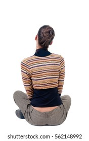 sitting young woman looks afar. Rear view. isolated over white.