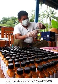 Sittwe Myanmar on August 19, 2015: a man was testing water quality sample