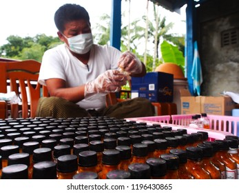 Sittwe Myanmar on August 19, 2015: A man was testing water sample for e-coli test