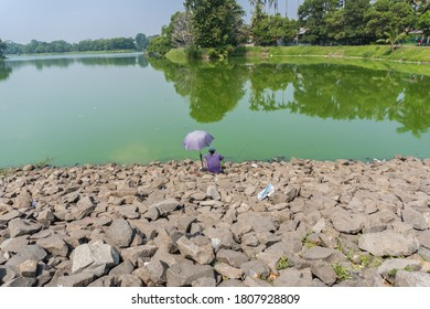 Situ Gintung, Tangerang - August 30, 2020: Photos of people fishing at Situ Gintung Dam, Tangerang.