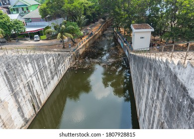 Situ Gintung, Tangerang - August 30, 2020: Photo of Situ Gintung Dam, this reservoir functions as a rainwater reservoir and for the waters of the surrounding agricultural fields.