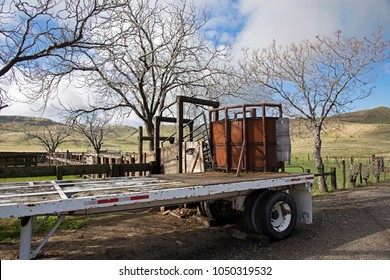 Situated in the foothills of the Sierra Nevada range, a loading chute and flatbed trailer on a Central California ranch await the spring roundup.