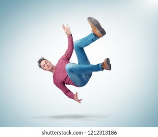 Situation, the man in casual clothes is falling. Concept of an accident