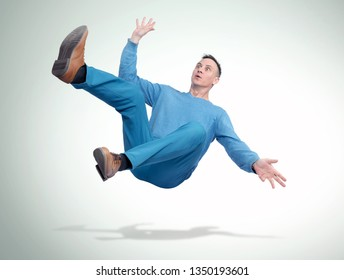 Situation, the man in casual clothes is falling down. Concept of an accident