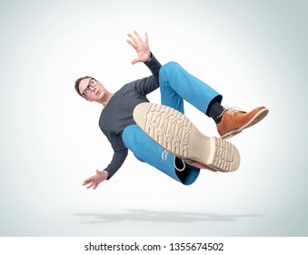 Situation, the man in casual clothes and glasses is falling down. Concept of an accident