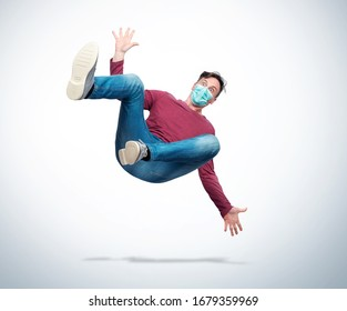 The situation, a man in casual clothes and a respiratory mask on his face is falling. Concept of an accident