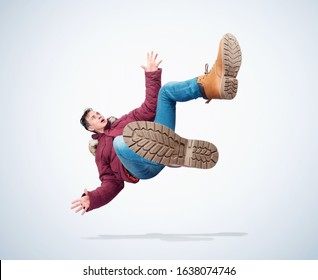 Situation, the man in red winter clothes is falling. Winter accident concept