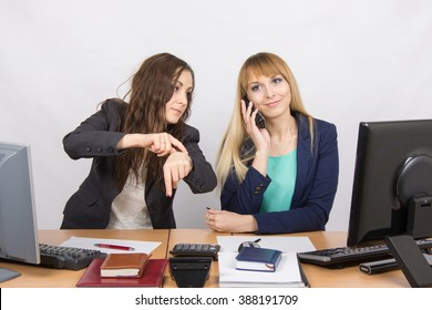 The situation in the office - the employee shows to watch that for a long time colleague talking on the phone
