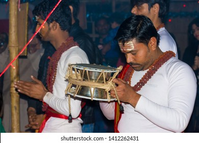 Siva Divotee playing  Damru Rattle Drum with all his heart, Allahabad, India. February 15 2019