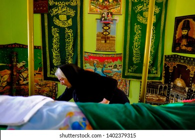 Sivas, Turkey – July 6, 2013 : Alevi woman prays while visiting shrine in the district of imranlı of Sivas province of Turkey.