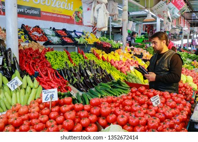 Sivas-Turkey, 20 March 2019: Farmer's Market Stand and Salesman. Salesman waiting to sale fruit and vegetables.Traditional Local Market in Sivas. Greengrocer selling farmer's produce. Vegetable Market