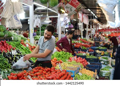 Sivas/Turkey, 4 July 2019:Turkish Market Place.People shoping vegetables at Farmers Market Place. Greengrocer selling vegetables.Costumer buying fruits.Turkish People at farmer's market.Turkish Vendor